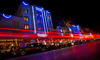 Tail lights streak as cars cruise the Art Deco district of Miami's South Beach.