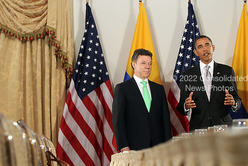 United States President Barack Obama (R) enters a bilateral meeting with President Juan Manuel Santos Calderon of Colombia, Friday, September 24, 2010 in New York City. Obama has been in New York since Wednesday attending the annual General Assembly at the United Nations, where yesterday he stressed the need for a resolution between Israel and Palestine, and a renewed international effort to keep Iran from attaining nuclear weapons..Credit: Spencer Platt - Pool via CNP.Credit: Spencer Platt - Pool via CNP