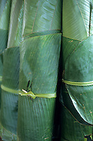 Rolls of banana tree leaves for sale at a market at Port Vila, Efate, Vanuatu.