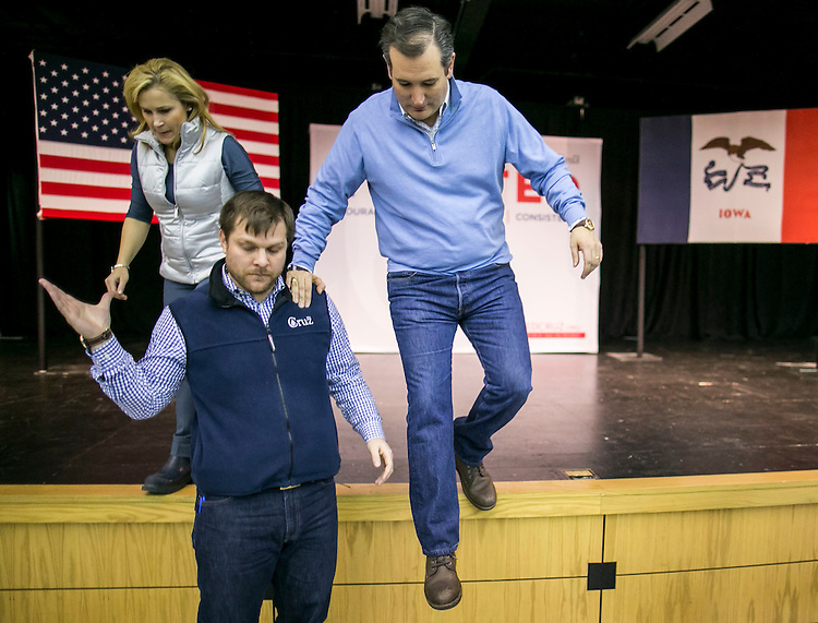 UNITED STATES - JANUARY 29 - Republican presidential candidate Sen. Ted Cruz, and his wife, Heidi, jump down to greet the crowd after a campaign stop, Friday, Jan. 29, 2016, in Wilton, Iowa.  (Photo By Al Drago/CQ Roll Call)