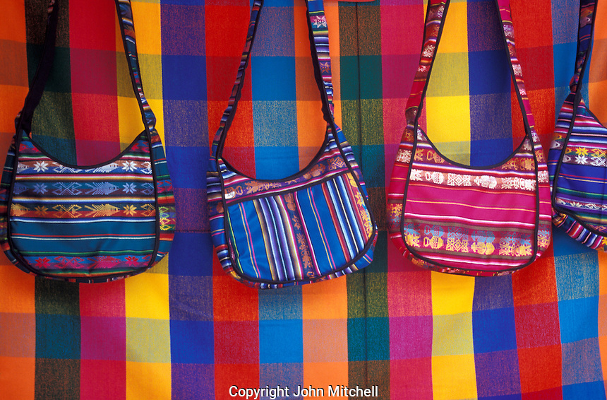 Woven bags for sale at the Handicrafts market in Poncho Plaza, Otavalo, Ecuador