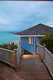 EXUMA Bahamas. Cottages and the grounds on Fowl Cay Resort at dusk.