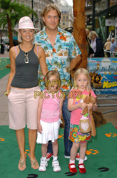 "LISA MAXWELL & FAMILY.At the Uk Premiere of ""Madagascar"",.Odeon Cinema Leicester Square, London, July 3rd 2005..full length shorts hat children daughterd kids husband?.Ref: CAN.www.capitalpictures.com.sales@capitalpictures.com.©Can Nguyen/Capital Pictures"