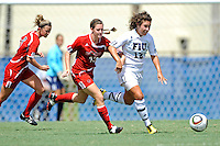 26 September 2010:  FIU's Kelly Ann Hutchinson (12) battles ASU's Christine Giles (13) for the ball in the second half as the FIU Golden Panthers defeated the Arkansas State Red Wolves, 1-0 in double overtime, at University Park Stadium in Miami, Florida.
