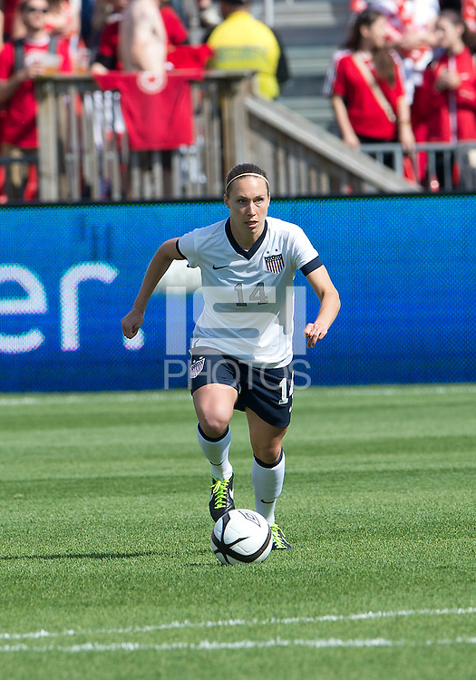 02 June 2013: U.S Women's National Soccer Team defender Whitney Engen #14 in action during an International Friendly soccer match between the U.S. Women's National Soccer Team and the Canadian Women's National Soccer Team at BMO Field in Toronto, Ontario.<br /> The U.S. Women's National Team Won 3-0.