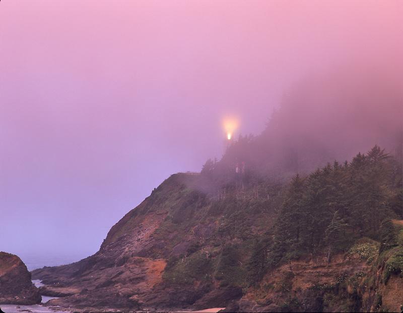 Light in fog from Heceta lighthouse, Oregon