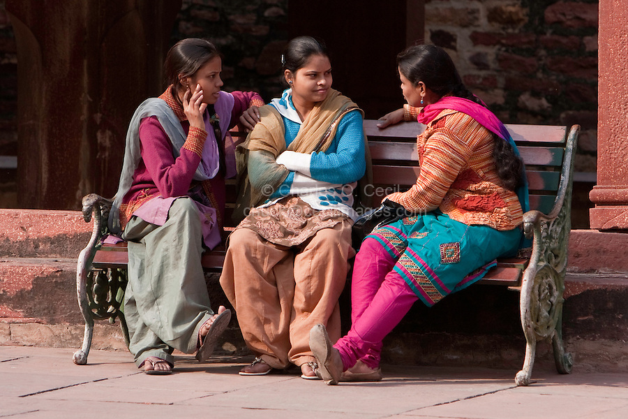 Fatehpur Sikri, Uttar Pradesh, India.  Indian Women Talking, Seated on Bench.