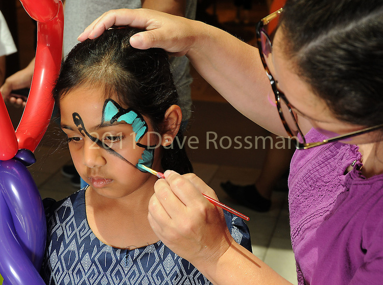 Kids receive face paint at the M.D. Anderson Back to School Fashion show at the Galleria Saturday Aug. 06,2016.(Dave Rossman Photo)