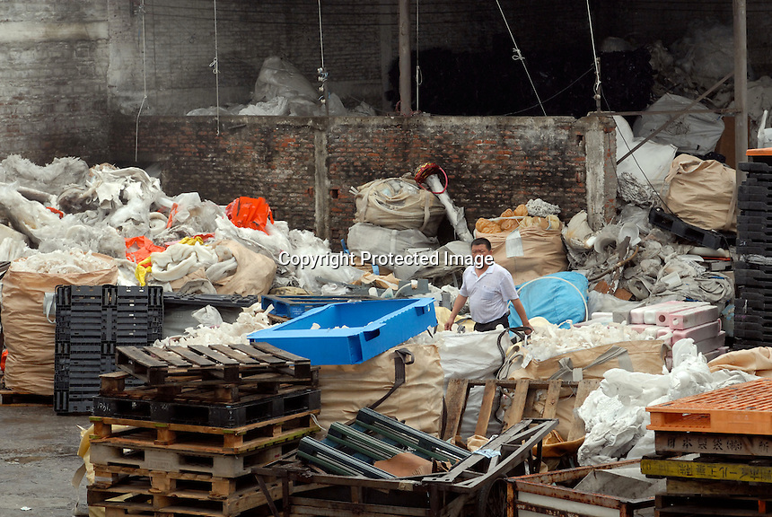 Rubbish is piled up at a recycling factory in Mai village, Shunde, China.  There is so much re-cycling in the area that the waste plastic spills out into streams and farmland polluting the environment.<br /> <br /> Photo by Richard Jones/ Sinopix