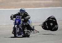 Mar. 31, 2012; Las Vegas, NV, USA: NHRA top fuel Harley motorcycle rider  Tony XXXX during qualifying for the Summitracing.com Nationals at The Strip in Las Vegas. Mandatory Credit: Mark J. Rebilas-