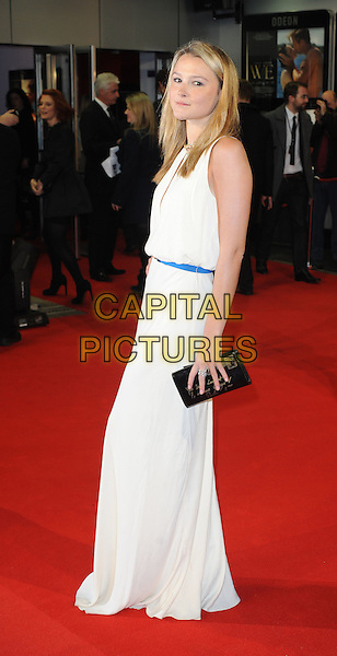 Amber Atherton.'W.E.' UK film premiere at Odeon cinema, Kensington, London, England..11th January 2011.full length white sleeveless dress clutch bag side.CAP/WIZ.© Wizard/Capital Pictures.
