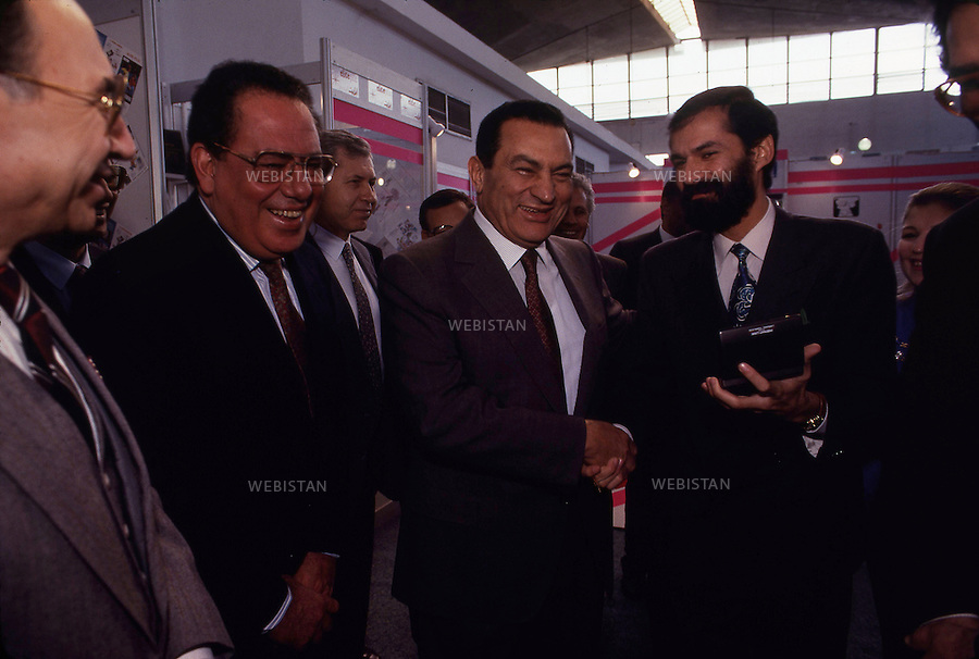 EGYPT, CAIRO, NASR CITY, CAIRO INTERNATIONAL CONFERENCE CENTER - 05/01/1992.The Cairo International Book Fair.In the middle : Hosni Mubarak, President of Arab Republic of Egypt since 1981.<br /> <br /> EGYPTE, LE CAIRE, NASR CITY, PALAIS DES CONGRES DU CAIRE - 05/01/1992.<br /> Le Salon International du Livre du Caire.<br /> Au milieu : Hosni Moubarak President de la Republique Arabe d'Egypte depuis 1981.