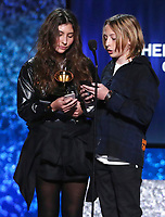 "Toni Cornell, left, and Christopher Nicholas Cornell accept the award for best rock performance for ""When Bad Does Good"" on behalf of their late father Chris Cornell at the 61st annual Grammy Awards on Sunday, Feb. 10, 2019, in Los Angeles. (Photo by Matt Sayles/Invision/AP)"
