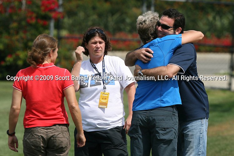 21 August 2009: United States Women's National Team Press Officer Aaron Heifetz (right) hugs USWNT head coach Pia Sundhage (SWE) as assistant coach Hege Riise (NOR) (left) watches. The Los Angeles Sol held a training session at the Home Depot Center in Carson, California one day before playing Sky Blue FC in the inaugural Women's Professional Soccer Championship Game.