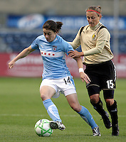 Chicago Red Star forward Karen Carney (14) is pressured by FC Gold Pride forward Tiffeny Milbrett (15).  The defeated the FC Gold Pride defeated the Chicago Red Stars 1-0 at Toyota Park in Bridgeview, IL on May 16, 2009.