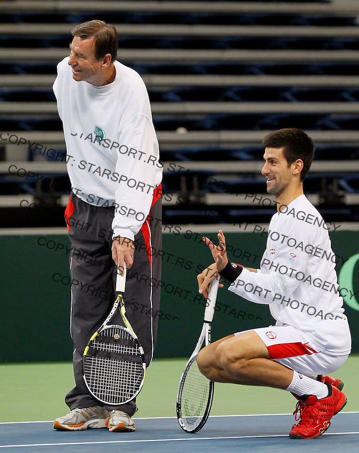 Serbia's player Novak Djokovic, right, joke with Nikola Pilic, Serbia'a team member, left, during a team training session in Belgrade, Serbia, Monday, Dec. 1, 2010. France will play against Serbia for the Davis Cup Final starting on December 3-5, in Belgrade. (Srdjan Stevanovic/Starsportphoto.com)