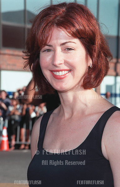 "25JUL99: Actress DANA DELANEY at the Los Angeles premiere of  ""Runaway Bride"" which stars Richard Gere & Julia Roberts..© Paul Smith/ Featureflash"