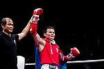 The judge rises the arm of Bayadaa Mendbayar (Red) of Mongolia as he wins the gold medal in the male muay 60KG division weight bout during the East Asian Muaythai Championships 2017 at the Queen Elizabeth Stadium on 13 August 2017, in Hong Kong, China.  Bayadaa Mendbayar won the gold over opponent Wong Kim Nam of Hong Kong. Photo by Yu Chun Christopher Wong / Power Sport Images