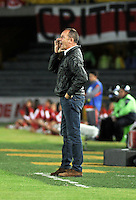 BOGOTA - COLOMBIA -22 -007-2014: Victor Fernandez, técnico de RC Deportivo de La Coruña de España, da instrucciones a los jugadores durante partido amistoso entre Independiente Santa Fe de Colombia y RC Deportivo de La Coruña de España,  en el estadio Nemesio Camacho El Campin de la ciudad de Bogota. / Victor Fernandez, coach of RC Deportivo de La Coruña of Spain gives instructions to the players during a friendly between Independiente Santa Fe of Colombia and RC Deportivo de La Coruña of Spain at the Nemesio Camacho El Campin Stadium in Bogota city, Photos: VizzorImage  / Luis Ramirez / Staff.