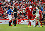 05.08.18 Aberdeen v Rangers: Windass indicates to ref Clancy he was pulled back for penalty