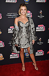 HOLLYWOOD, CA - JUNE 22: Olivia Holt arrives at the 2018 Radio Disney Music Awards at Loews Hollywood Hotel on June 22, 2018 in Hollywood, California.