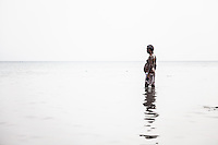 An Indian bather on the Dead Sea. Palestinian Territory