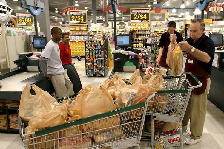 Brandon, who's off from school this week, accompanies Rosemary Revis to shop for their week's worth of food for the food portrait at the Harris Teeter supermarket, a short drive from their suburban home in Raleigh, North Carolina. (Supporting image from the project Hungry Planet: What the World Eats.)