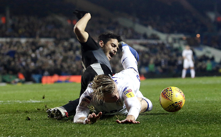 Leeds United's EzgjanAlioski goes down in the penalty area under the challenge from Reading's Tiago Ilori and receives a yellow card by Referee Michael Dean for his efforts<br /> <br /> Photographer Rich Linley/CameraSport<br /> <br /> The EFL Sky Bet Championship - Leeds United v Reading - Tuesday 27th November 2018 - Elland Road - Leeds<br /> <br /> World Copyright © 2018 CameraSport. All rights reserved. 43 Linden Ave. Countesthorpe. Leicester. England. LE8 5PG - Tel: +44 (0) 116 277 4147 - admin@camerasport.com - www.camerasport.com