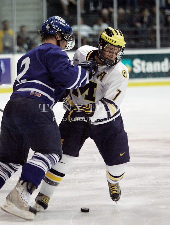 2 Oct 2005: Michigan's T.J. Hensick (7) competes for the puck with Toronto's Andrew Jakubaitis (2) during Michigan's 3-2 victory over Toronto at Yost Ice Arena in Ann Arbor, MI.