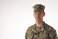 US army or navy man in uniform, model released, DoD-compliant for advertising, framed for type