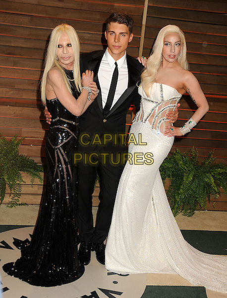 02 March 2014 - West Hollywood, California - Donatella Versace, Nolan Funk, Lady Gaga. 2014 Vanity Fair Oscar Party following the 86th Academy Awards held at Sunset Plaza. <br /> CAP/ADM/BP<br /> &copy;Byron Purvis/AdMedia/Capital Pictures