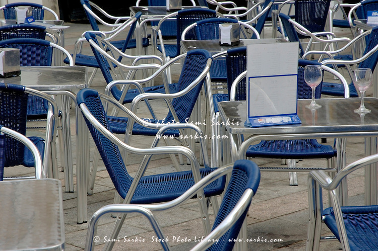 Empty metallic chairs on a cafe terrace, Cordoba, Andalusia, Spain.