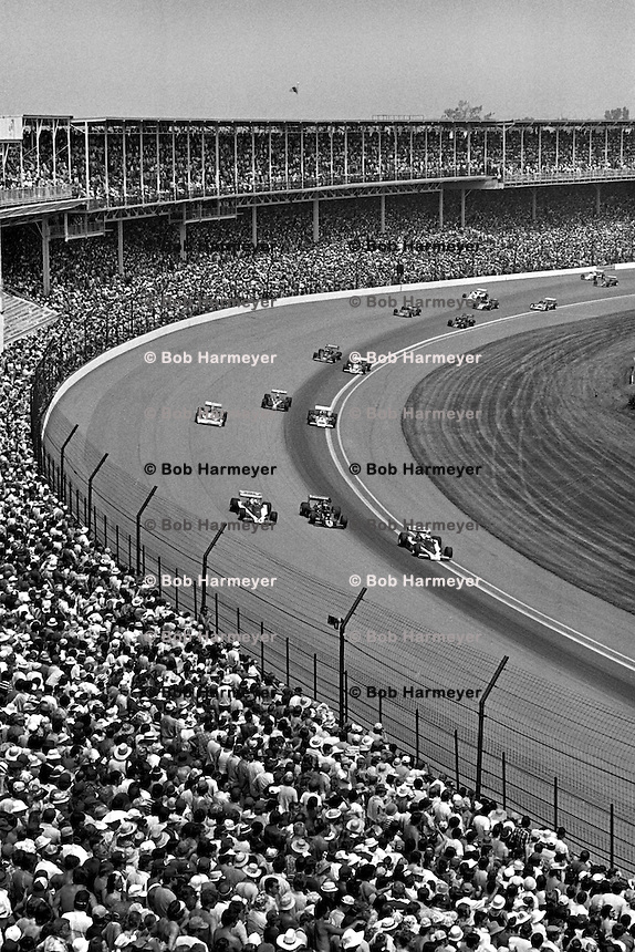 INDIANAPOLIS, IN - MAY 28: The front row of Tom Sneva, Danny Ongais and Rick Mears lead the field through Turn 1 during a parade lap before the Indy 500 at the Indianapolis Motor Speedway in Indianapolis, Indiana, on May 28, 1978.