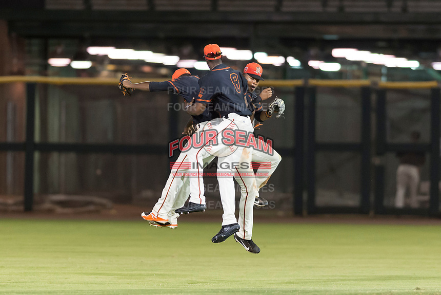 AZL Giants Black outfielders Alexander Canario (14), Kwan Adkins (8), and Randy Norris (1) celebrate a victory after an Arizona League game against the AZL Rangers at Scottsdale Stadium on August 4, 2018 in Scottsdale, Arizona. The AZL Giants Black defeated the AZL Rangers by a score of 6-3 in the second game of a doubleheader. (Zachary Lucy/Four Seam Images)