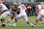 Noah Osur-Myers blocks the on-coming rush during the annual Washington State Cougar spring game, the Crimson and Gray game, at Joe Albi Stadium in Spokane, Washington, on April 23, 2016.