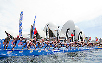 10 APR 2011 - SYDNEY, AUS - Competitors dive into the water for the start, in front of the Sydney Opera House, of the women's ITU World Championship Series triathlon in Sydney, Australia .(PHOTO (C) NIGEL FARROW)