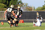 Palos Verdes CA 10/22/10 - Walter Woo (Peninsula #2), Logan Okuda (Peninsula #25), Tommy Webster (Peninsula #49) and Ivan McLennoan (C) (Leuzinger #3) in action during the Leuzinger - Peninsula varsity football game at Palos Verdes Peninsula High School.