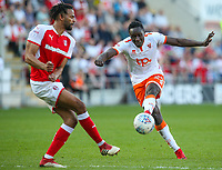 Blackpool's Daniel Agyei shoots just wide under pressure from Rotherham United's Michael Ihiekwe<br /> <br /> Photographer Alex Dodd/CameraSport<br /> <br /> The EFL Sky Bet League One - Rotherham United v Blackpool - Saturday 5th May 2018 - New York Stadium - Rotherham<br /> <br /> World Copyright &copy; 2018 CameraSport. All rights reserved. 43 Linden Ave. Countesthorpe. Leicester. England. LE8 5PG - Tel: +44 (0) 116 277 4147 - admin@camerasport.com - www.camerasport.com