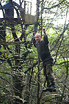 Gaz, one of a group of campaigners and residents of the Nine Ladies protest camp at Stanton Lees, near Matlock in Derbyshire, pictured at the camp in the Derbyshire Dales preparing to dismantle one of the abandoned tree houses. The ancient woodland and Nine Ladies stone circle were threatened by a proposed quarry near the site. Following a nine year campaign by protesters the quarry proposal has now been rejected, and the camp will soon be dismantled and vacated.