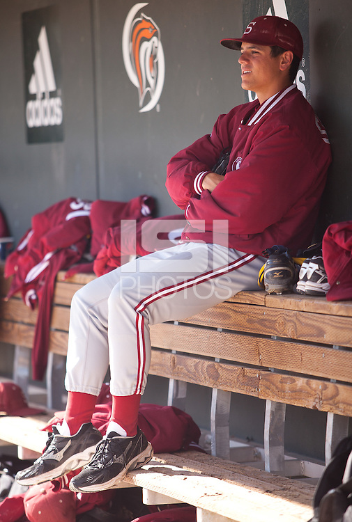 STOCKTON, CA - May 9, 2011: Starting pitcher A.J. Vanegas of Stanford baseball sits in the dugout during warmups before Stanford's game against Pacific at Klein Family Field in Stockton. Stanford won 11-5.