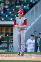 Preston Palmeiro (12) of the North Carolina State Wolfpack waits at home plate after scoring on the home run hit by Andrew Knizner (not pictured) during the game against the Charlotte 49ers at BB&T Ballpark on March 31, 2015 in Charlotte, North Carolina.  The Wolfpack defeated the 49ers 10-6.  (Brian Westerholt/Four Seam Images)
