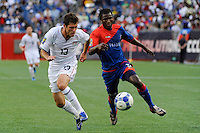 Colin Clark (13) of the United States (USA) and Judelin Aveska (8) of Haiti (HAI). The United States and Haiti played to a 2-2 tie during a CONCACAF Gold Cup Group B group stage match at Gillette Stadium in Foxborough, MA, on July 11, 2009. .