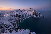 Winter view over Kvalvika beach from the summit of Ryten, Moskenesøy, Lofoten Islands, Norway