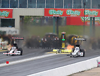 May 20, 2017; Topeka, KS, USA; NHRA top fuel driver Steve Torrence (left) races alongside Antron Brown during qualifying for the Heartland Nationals at Heartland Park Topeka. Mandatory Credit: Mark J. Rebilas-USA TODAY Sports