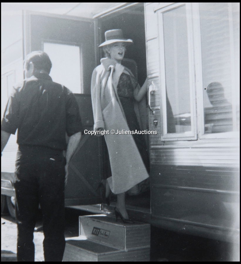 BNPS.co.uk (01202 558833)<br /> Pic: JuliensAuctions/BNPS<br /> <br /> A photo from an extra on the set of Bus Stop and believed to have never been seen before, show a smiling and happy Marilyn Monroe at Arizona State fairgrounds.<br /> <br /> A huge archive of candid photographs of screen siren Marilyn Monroe taken by a superfan she befriended has emerged for sale for a staggering £320,000.<br /> <br /> The collection includes more than 550 colour and black and white snaps, some of which have never been seen before, that were taken by fan-turned-friend Freda Hull.<br /> <br /> Monroe was notoriously guarded but welcomed Mrs Hull and her five friends into her inner sanctum, often giving them gifts and even once inviting them for a picnic at her home in Connecticut.<br /> <br /> The archive, which also boasts 150 colour slides, 750 stills from Monroe's films and a collection of personal home movies, is tipped to fetch £320,000 when it goes under the hammer at Julien's Auctions.