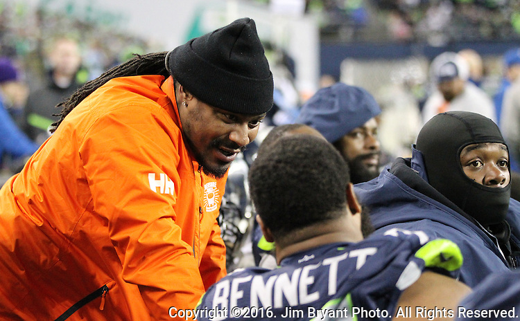 Former Seattle Seahawks running back Marshawn Lynch, left, talks to Seattle Seahawks defensive end Michael Bennett (72) during their game against the Carolina Panthers at CenturyLink Field in Seattle, Washington on December 4, 2016.  Seahawks beat the Panthers 40-7.   ©2016. Jim Bryant photo. All Rights Reserved.