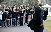 United States President Barack Obama waves as he walks out of the residence toward Marine One while departing the White House, on February 10, 2016 in Washington, DC. President Obama is traveling to Springfield, Illinois where he will address the Illinois General Assembly.<br /> Credit: Olivier Douliery / Pool via CNP