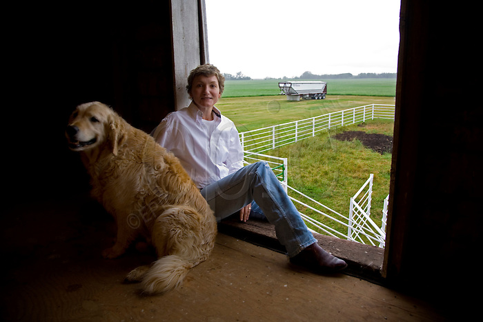 Debbie Trelenberg, with her dog Bobo at her Leduc, Alberta farm on July 30, 2008.  Trelenberg had to travel to Texas to have a large tumour removed from her abdomen last summer, after learning she would have to wait almost one month to have it removed in Edmonton. .John Ulan/Epic Photography...