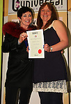 Ann McLoughlin receives her runner-up certificate in adult poetry from Mona Daly..Picture: Shane Maguire / www.newsfile.ie.