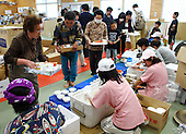 May 18, 2011; Minamisanriku, Miyagi Pref., Japan - 5:51 p.m. Evacuees line up for dinner at the Shizukawa High School Evacuation Center in Minamisanriku after the magnitude 9.0 Great East Japan Earthquake and Tsunami that devastated the Tohoku region of Japan on March 11, 2011.